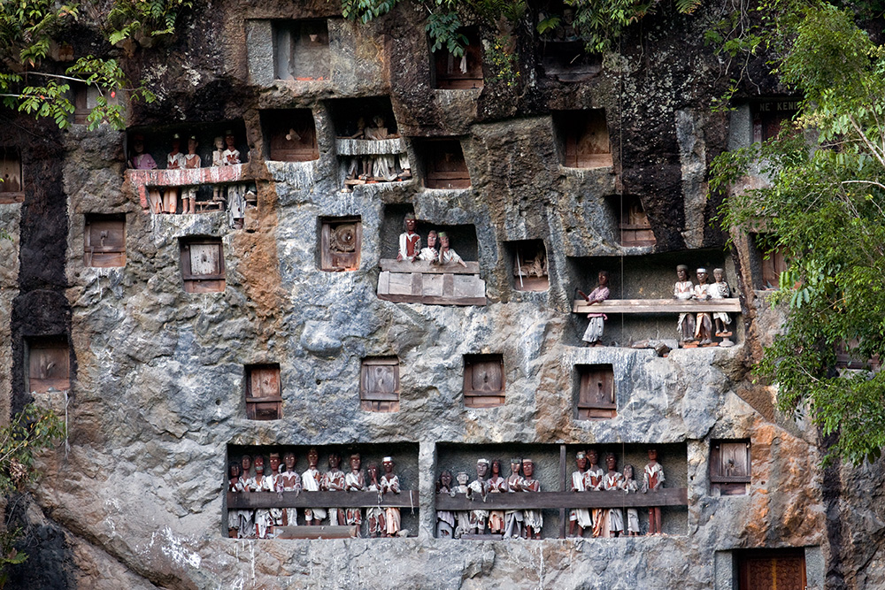 There are several types of graves used in Toraja culture. One of them is digged in a rock. The statues representing the deceased are put in the grave together with a coffin or placed on a balcony nearby.