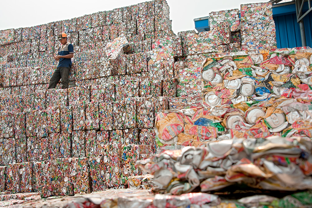 Blocks of pressed aluminium cans in a large waste warehouse and processing factory in Phnom Penh.